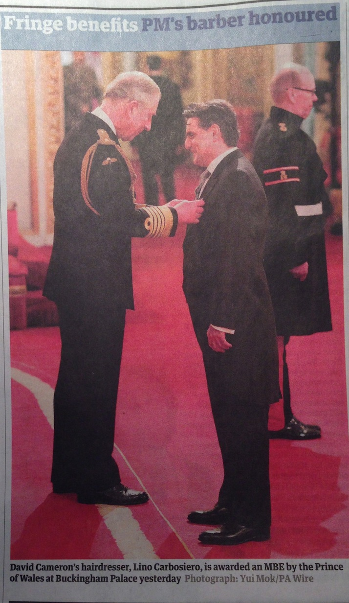 Lino Carbosiero receives his MBE from Prince Charles
